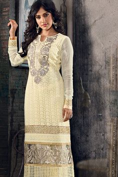 Ivory Designer suit with silver jari work gives royal decent look...