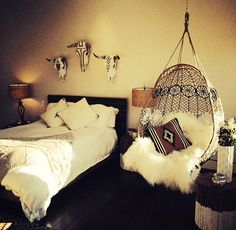 """Hipster"" bedroom. I absolutely love the hanging chair. Where can I get one like that?"