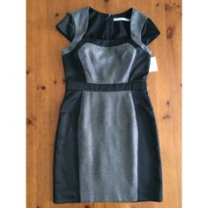 Andrew Marc Office Dress-Slv/Blk Elegant NWT Sz8 Ideal work dress. Super high quality design tailoring and materials.  The luminous silver vs. the glossy black is so pretty, and the cap sleeve design is genius. This is your power dress/ you OWN the room. Looks really really expensive.  Doesn't fit and I own it.   Still in the box it came in. Exiting Posh for $$ sites in Dec. ⚡️ Andrew Marc Dresses