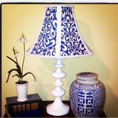 DIY lampshade: 1/2 yard of fabric, 3 yards of trim,clear fabric glue, and plain lamp shade. Cut each panel and cover edges with trim!