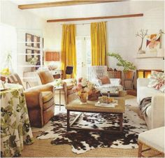 color palette + cowhide layered on larger area rug (jute or sisal)