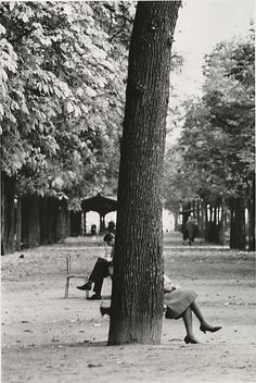 Who is waiting just out of view at The Champs Elysées, Paris ? Is our ingenue, Pip, expecting to meet up with someone...?  Or is it Harris, further afield reading a newspaper for clues...?  photo by André Kertész
