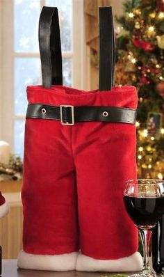 Santa Pants Wine Bag by giftcraft. $15.99. 10.4x3.8x19.5. Polyester wine bag holds 2 bottles of wine. Great gift to take with you to a party around Christmas time. Great hostess or Christmas gift.