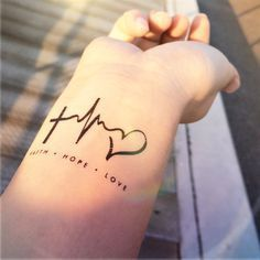 "FAITH LOVE HOPE heartbeat tattoo InknArt Temporary by InknArt [   ""FAITH LOVE HOPE heartbeat tattoo not crazy about needles but I like this tattoo and thinking about getting it one day"",   ""I just like the heart bit"",   ""Well except this is fake, we should get these with the addition of sisters in front so the bottom read family.love its our life summed up!"",   ""Something like this, but with"