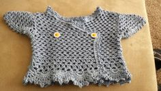 Crocheted baby top.