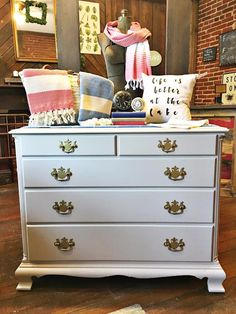 What a sweet little thing this is by Red Door Furniture Co! This dresser was painted in a custom mix of General Finishes Millstone and Snow White Milk Paint.