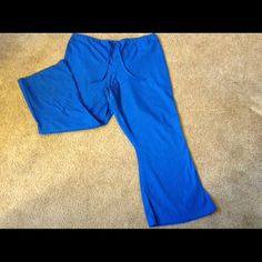 Cherokee Scrub Pants Royal Blue. Elastic on back, draw string on front. Flares. 2 pockets--1 on each side. 1 pocket on right behind cheek. Cherokee Pants