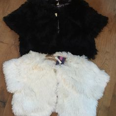 Shaggy dressy shawl Children's dressy shaggy long faux fur shawl. Brand new never worn. Tags still on it. Beautiful for holidays and special occasions. Dresses up children's dresses or skirts or pants. Satin lined. 100% poly. One black shawl and one white shawl. Both can be sold one if you just want one. Jackets & Coats Capes