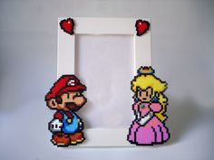 Paper Mario Picture Frame - White Frame with Mario & Peach - Horizontal or Vertical. €17.00, via Etsy.