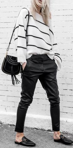 white and black outfit: bag + grafic top + pants