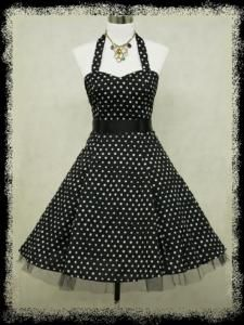 Black halter dress with medium white polka dots, with built-in black netting underskirt. About $47 (29.99 GBP) plus 14 shipping (8.50 GBP)