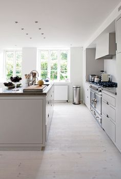 White cabinets, light floors, browny grey counters