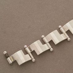 Hans Hansen Bold Modernist Bracelet   From a unique collection of vintage modern bracelets at http://www.1stdibs.com/jewelry/bracelets/modern-bracelets/