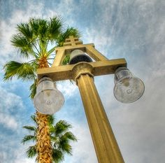 Downtown Riverside street lamp with Riverside's Raincross Logo.