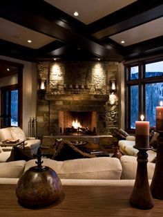 Wherever this is, please take me there! Decorated in just wood, stone and a soothing soft cream color makes up this elegant mountain dream home. Everything is this home is so welcoming and is beckoning for you to enjoy the fire and relax the evening away in complete comfort after a long day of playing in the snow. I love those thick wood-ceiling beams