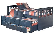"""The Leo Youth Trundle Bed w/ Storage from Ashley Furniture HomeStore (AFHS.com). The comfortable cottage design of the """"Leo"""" youth bedroom collection features a replicated blue paint finish flowing beautifully over the grooved panels and embossed bead framing to make this innovative furniture an inviting addition to any child's bedroom."""