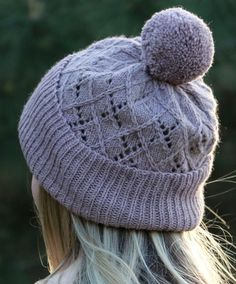 Free Knitting Pattern for Argyle Hat - Beanie with fold up ribbed brim and argyle inspired lace crown. Sport yarn. Designed by Kaitlin Blasing