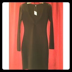 UK2LA Black Dress with Mesh Long Sleeves Never worn. Only tried on. V-neck style. Looks long but once you have it on it's really not. Size medium. Sleeves are long sleeved and are mesh. Very comfortable. Still has tags on it. UK2LA Dresses Long Sleeve