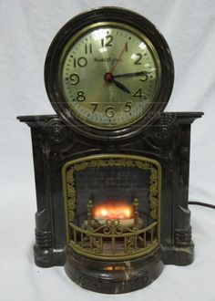 Vintage Master Crafters Fire Place Clock Vintage Master Crafters fire place clock A beautiful, working clock circa Simulated flame on a rotating log Plastic body - Metal back Brown marble color Chord is in great shape Backing.