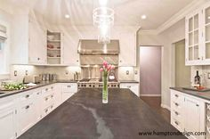I do love this  Jet Mist Honed Black Granite countertops as a contrast to the white marble