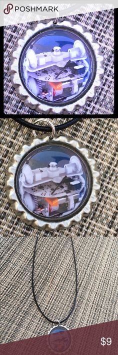 """Handmade Star Wars inside BB8 bottlecap necklace Handmade Star Wars inside of BB8 bottle cap necklace. 18"""" faux leather adjustable cord Jewelry Necklaces"""