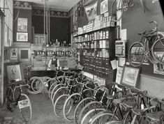 "1910. ""Cycle shop interior. Christchurch, New Zealand."" B.S.A. stood for Birmingham Small Arms. Photo by Steffano Francis Webb."