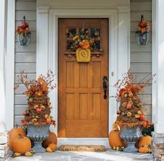 autumn door decorations | love the topiaries and detail on the coachlights. I have two large ...