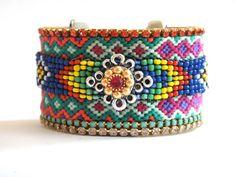 Native American beadwork cuff - friendship bracelet cuff with swarovski chrystal rhinestones - bohemian hippie bracelet. €100.00, via Etsy.