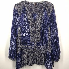 Free People blue peasant blouse size XS This free people blouse is a mix of two blue prints. It is oversized in fit. It has a drop waist draw string detail. Very clean! Like new! Free People Tops Blouses