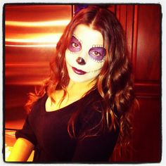 Dia de los muertos makeup.  Purple shadow great for green eyes.  Notice loops don't have to go all the way around eyes.  Dark purple lipstick is cool too.