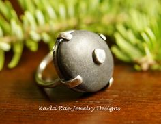 Lake Superior stone with ball of fine silver embedded into it, set in hand fabricated sterling silver setting.  Karla Rae Jewelry Designs