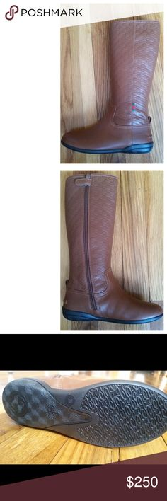 """Kids Gucci boots You are viewing a pair of 100% authentic kids GUCCI riding boots. These boots are brand new and are all leather. They are caramel brown with an embroidered double """"G"""" all over the boots. They are a size 29 equivalent to an 11 and a half 12.  They are 11"""" high. Comes with original box. Gucci Shoes Boots"""
