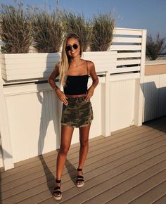 Starting off the week with Jenna Cooke 😻 she looks absolutely … Happy Monday! Starting off the week with Jenna Cooke 😻 she looks absolutely stunning in our Madison Black Tank x Zip It Camo Skirt combo 🖤 Unique Outfits, Trendy Outfits, Cool Outfits, Fashion Outfits, Style Fashion, Cute Concert Outfits, Fashion Shirts, Black Outfits, Trendy Clothing