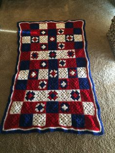 Red, white and blue granny square blanket full view.