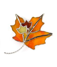 Handmade stained glass maple leaf pin. Beautiful fall colors!