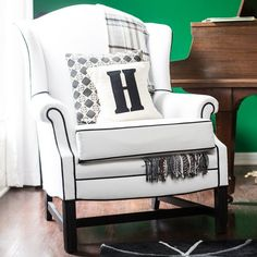 This old wingback chair fell off a truck on the freeway before we got it… you'll never believe the BEFORE picture.