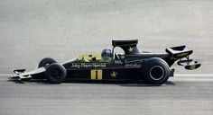 Ronnie Peterson in his 1974 Lotus 76, with the bizarre but interesting (and, sadly, ineffective) biplane rear wing. Peterson was in the odd position of racing with the #1 on his car despite not being the champion (Lotus had won the constructor's championship in '73, but his teammate Emerson Fittipaldi left at the end of that season for MacLaren). In keeping with the F1 numbering system, Lotus had #1 and #2 for their drivers in 1974, giving the remaining Peterson the numero uno. A...