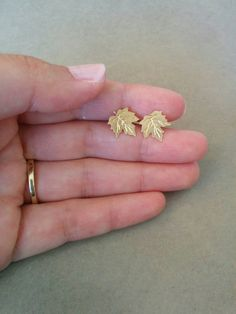 A beautiful simple leaf stud earrings. Made of gold plated brass base, matte finish. Dimensions: Length: inch 1 cm Width: inch 1 cm Item will be shipped in a branded gift box. Triangle Earrings, Small Earrings, Leaf Earrings, Stud Earrings, Diamond Earrings, Gold Earrings Designs, Gold Jewellery Design, Ring Designs, Gold Choker Necklace