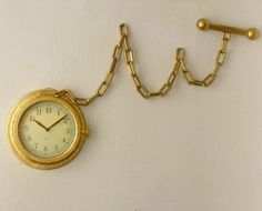 DIY Pocket watch wall clock    http://www.designsponge.com/2010/05/diy-project-halligans-pocket-watch-wall-clock.html