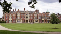 Sandringham House is a country house on 20,000 acres of land near the village of Sandringham in Norfolk, England.
