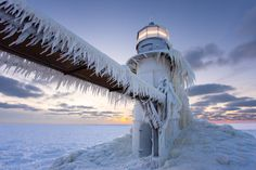 An image from the timelapse video: Lighthouse Ice showing the St. Joseph, Michigan lighthouse covered in ice on January 8, 2014 after the polar vortex weather event.