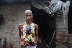 TRIBUTE: Prasenjit Ghosh, the younger brother of a rape victim, held his sister's picture at his home in Barasat, India, Monday. Police said they have arrested six men in connection with the rape and murder of the 20-year-old, who was attacked as she returned home from college on Friday. (Piyal Adhikary/European Pressphoto Agency)