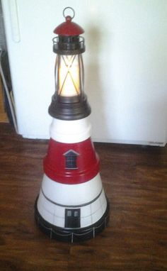 Fall River Borden Flat lighthouse that is made from clay pots call if interested.