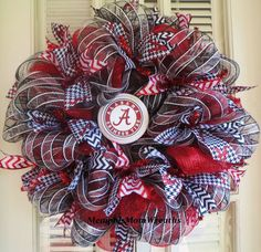 "Make your door to scream ""Roll Tide Roll"" with this Alabama Deco Mesh Wreath. Measuring a huge 24"" diameter, this deco mesh wreath features classic Bama elements: crimson red, Bear Bryant houndstooth, and the Bama school logo in the center. $59.00. Etsy.com/shop/memphismomwreaths"