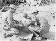 WWI, 20 Sept A wounded South African soldier is given a hot drink by a padre after the attack on 'Potsdam', a German stronghold near Zonnebeke, during the Battle of the Menin Road Ridge near Potijze. © IWM (Q World War One, First World, Battle Of Passchendaele, Lest We Forget, Wwi, Photos, History, Soldiers, Africans