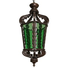 Italy  1920s  Italian dark wood lantern carved with leaf and frond details, and etched green glass panels.