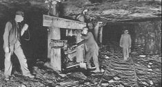 One of the most dangerous aspects of coal mining was the possibility of an open flame, spark or blasting charge igniting methane gas or coal dust. In this 1910 photo miners are picking up a flame safety lamp before proceeding to their work place. The hand-written sign says NO OPEN LIGHTS.  Mine Safety