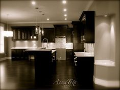 Dark wood cabinet, dark wood floors, grey splash back, stainless stain appliances, granite counter tops