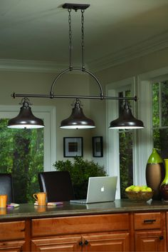 This metal shaded fixture is an elegant nod to the past. The classic Americana styling adds a nostalgic flair to your home. When hung over a kitchen island or dinette table it provides ample lighting for all your daily tasks. It is available in four fabulous finishes Brushed Nickel Imperial Silver Palladian Bronze and Weathered Brass [source: Quoizel]. Be creative in your design ideas.