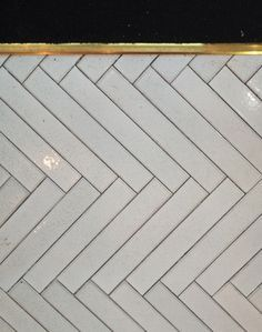 herringbone tiles with brass inlay - Google Search